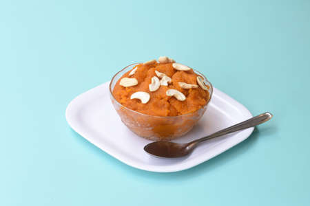 Indian traditional sweet,Plain SemolinaSuji Halwa also known as Sweet Rava Sheera OR Shira - Indian festival sweet garnished with dry fruitsServed in a plate or Bowl,Indian dessert