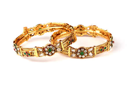 Indian golden Bangles. Bracelet with diamonds and stones on a white background, Indian Traditional Jewellery,Style, fashion and design of jewelry Standard-Bild