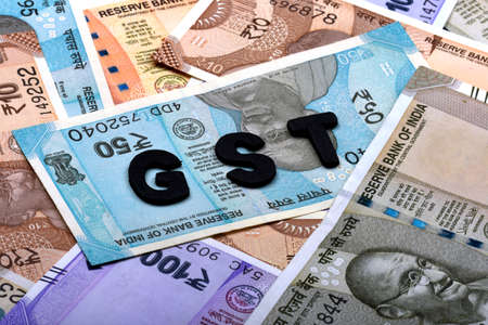 GST concept,GST alphabet on money background,business and financial concept idea,Indian Currency, Rupee, Indian Rupee,Indian Money, Business, finance, investment, saving and corruption - Image