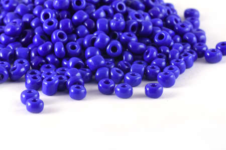 Close up of blue Beads on the white background. Background or texture of beads. macro,It is used in finishing fashion clothes. make bead necklace or string of beads for woman of fashion.