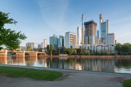 The skyscrapers of Frankfurt am Main are shrouded in a warm light shortly after sunrise - Frankfurt, Germany