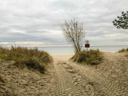 The German Baltic Sea coast on the island of Usedom is known for the beautiful sandy beach. Sand that the sea washes away during a storm is heaped up again with heavy equipment.