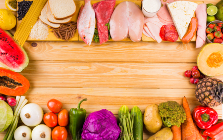 carbohydrates: table full of all kinds of food in our daily diet includes proteins, carbohydrates, fats, vegetables and fruits Stock Photo