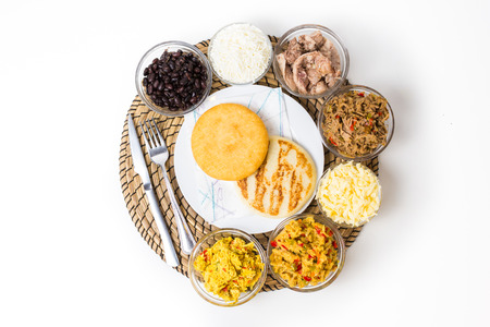 Venezuelan typical food, arepas and their different combinations. Chicken, fish, meat, cheese, black beans and pork.