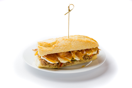 Meat sandwich with sweet onion and goat cheese. Venezuelan food on white background Stock Photo