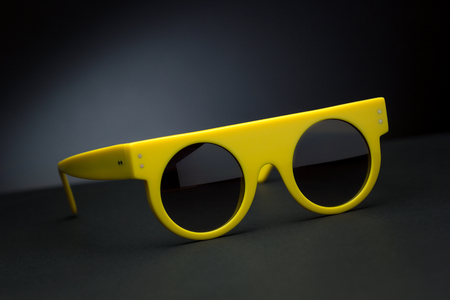 Stylish sunglasses for summer on a black background