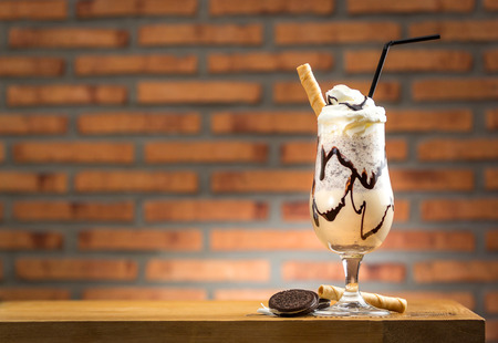 Homemade milkshake (chocolate smoothie) with cookies on rustic wooden table Stock Photo