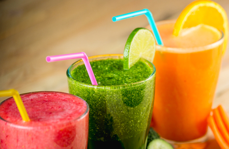Blended fruit smoothies on wood table
