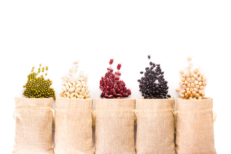 Different types of grains on white background