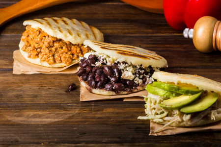 Three types of arepas, Latin American food on wood table