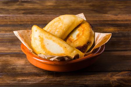 Venezuelan typical food, Empanadas on wood table ready to eat Stock Photo