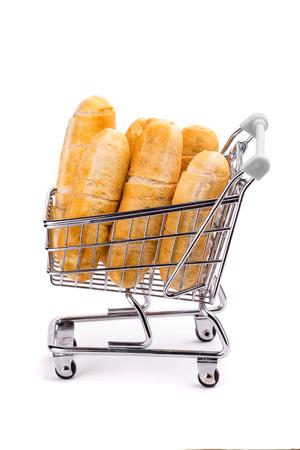 Venezuelan tequenos inside a shopping cart on a white background.