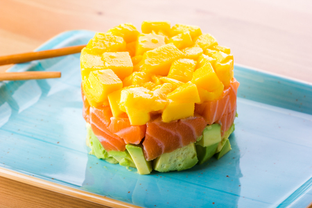 salmon tartar, avocado and mango, mix of latin and japanese food
