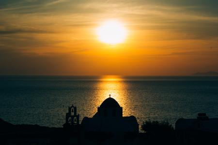 Beautiful sunset on Santorini island, Greece. Romantic landscape with sea view, orange color 版權商用圖片