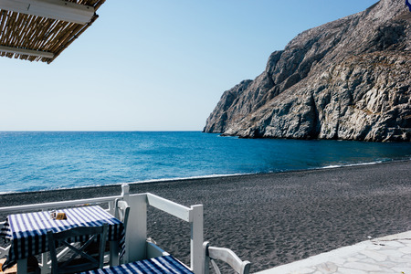 The black volcanic beach at Kamari Santorini Greece, a unique view Stock Photo