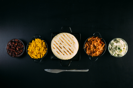 Top view of South American food called arepa and different ingredients 스톡 콘텐츠