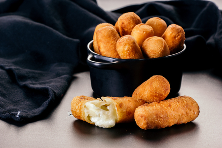 Appetizers called Tequeños made of fried corn filled with cheese