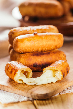 Cheese fingers, typical Venezuelan appetizer called tequeños  on a wooden board 版權商用圖片