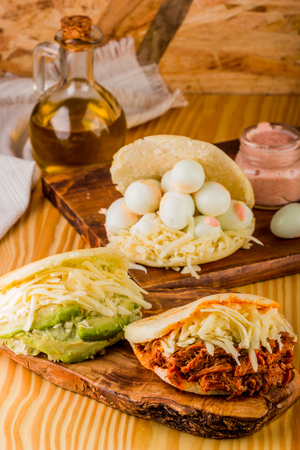 Various types of arepas with different fillings, Latin American food