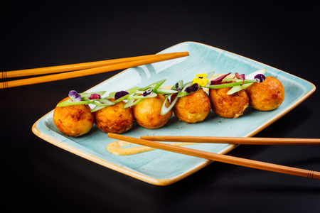 Japanese food, salmon croquettes on a black background