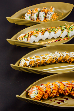 A diverse selection of delicious Japanese sushi rolls