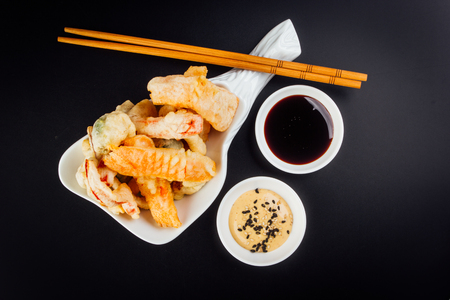 Delicious tempura vegetables ideal for vegetarians on a black background