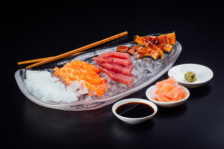 Small fillets of salmon, tuna, cuttlefish, and eel completely fresh and ready to eat