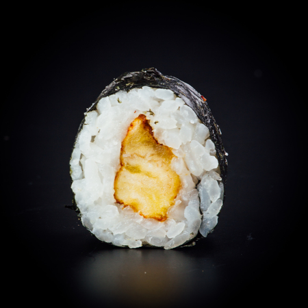 Fried plantain maki sushi rolls on a black background, japanese food