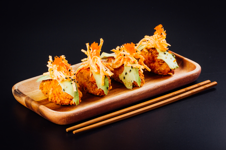 Japanese food, salmon croquettes on a black background 版權商用圖片 - 121475426