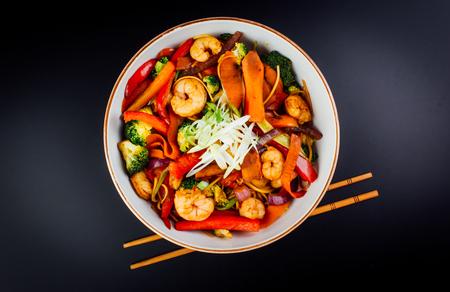 Vegetables and shrimps in  bowl. black background. japanese food 版權商用圖片