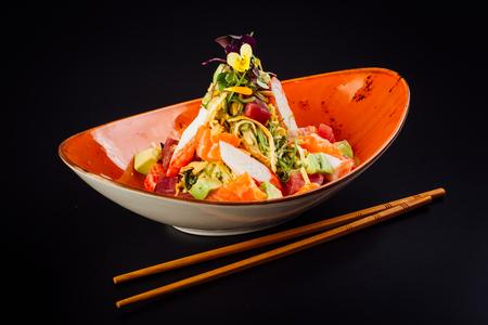 Salad with surimi, avocado, salmon and tuna. 版權商用圖片