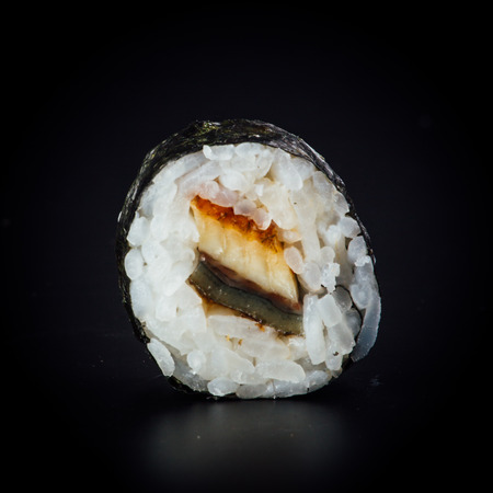 Eel maki sushi rolls on a black background, japanese food