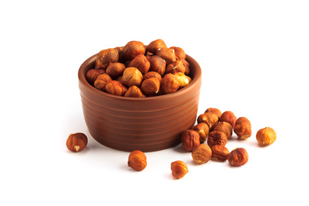 bowl full of hazelnuts isolated on a white background Stok Fotoğraf