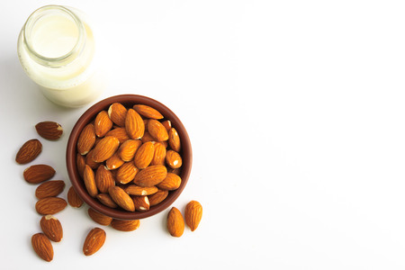 Top view of Milk and bowl of almonds isolated on a white background Stok Fotoğraf