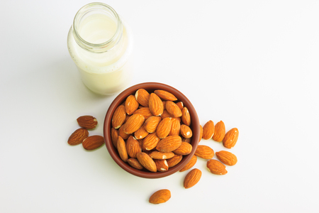 Top view of Milk and bowl of almonds isolated on a white background 版權商用圖片