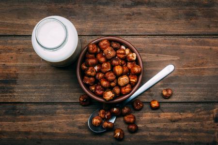 Hazelnut milk isolated on a wood background, vegan milk Stok Fotoğraf