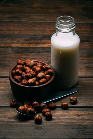 Hazelnut milk isolated on a wood background, vegan milk 版權商用圖片
