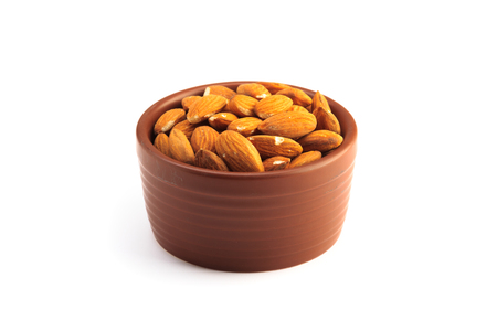 Bowl full of almonds and isolated on a white background 版權商用圖片 - 123030089