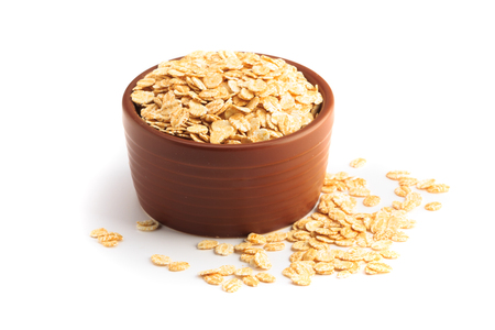 Bowl full of flaked oats on a white background Stok Fotoğraf