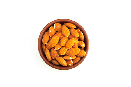 Top view of bowl full of almonds and isolated on a white background 版權商用圖片 - 123030093