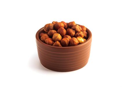 bowl full of hazelnuts isolated on a white background 版權商用圖片