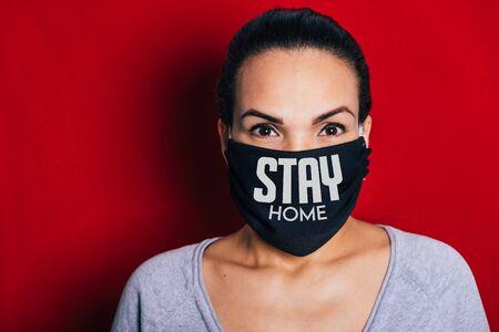 Woman wearing a black mask worried about the coronavirus pandemic. Stok Fotoğraf