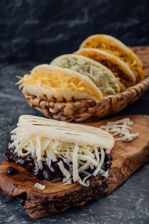 Top view of various types of typical Venezuelan arepas in a woven basket 版權商用圖片