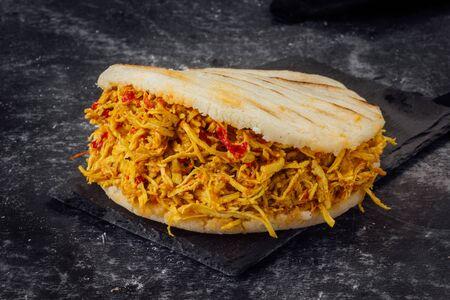 Arepa with chicken in strips. (Arepa pelua) Venezuelan typical food