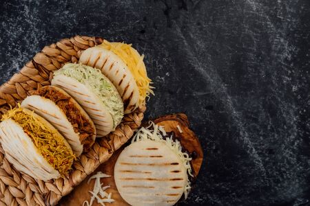 Top view of various types of typical Venezuelan arepas in a woven basket Stok Fotoğraf