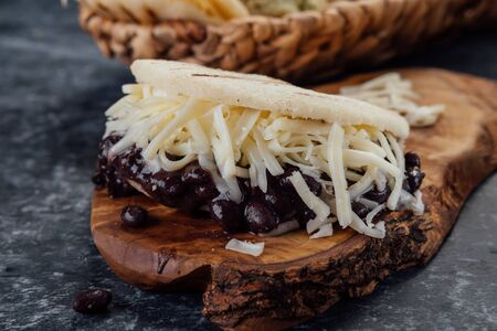 Arepa with black beans and white cheese. (Arepa domino) Stok Fotoğraf
