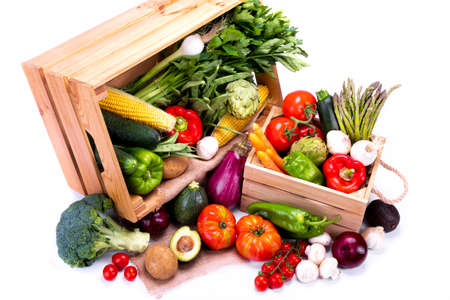 Top view of wooden boxes full of fresh vegetables on a white background, ideal for a balanced diet Stock Photo