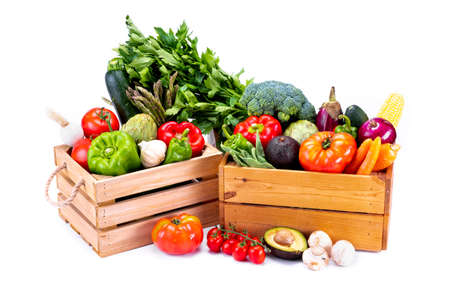 Healthy fresh vegetables in wooden boxes on white background, healthy food