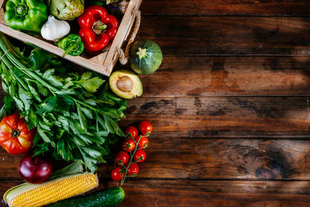 Top view of fresh vegetables on a wooden table, balanced diet
