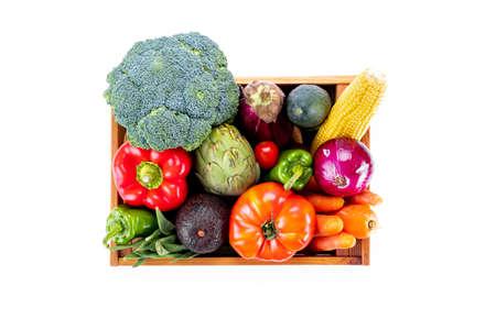 Box full of colorful fresh vegetables on white background Stock Photo